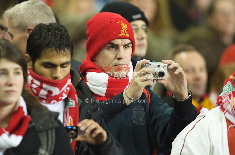 LIVERPOOL, ENGLAND - Wednesday, March 5, 2008: Liverpool fans take photographs with digital cameras during the Premiership match at Anfield. (Photo by David Rawcliffe/Propaganda)