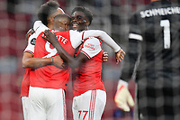 Football - 2019 / 2020 Premier League - Arsenal vs. Leicester City<br /> <br /> Arsenal's Pierre-Emerick Aubameyang (hidden) celebrates scoring his side's first goal with Alexandre Lacazette and William Saliba, at the Emirates Stadium.<br /> <br /> COLORSPORT/ASHLEY WESTERN