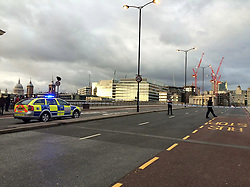 © Licensed to London News Pictures. 14/10/2015. London, UK. London Bridge in central London is currently closed by police due to a suspect package. traffic in both directions over the bridge has been stopped. . Photo credit: Asim Chamling Rai/LNP