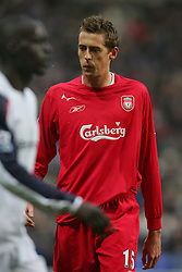 BOLTON, ENGLAND - MONDAY, JANUARY 2nd, 2006: Liverpool's Peter Crouch spits  against Bolton Wanderers during the Premiership match at the Reebok Stadium. (Pic by David Rawcliffe/Propaganda)