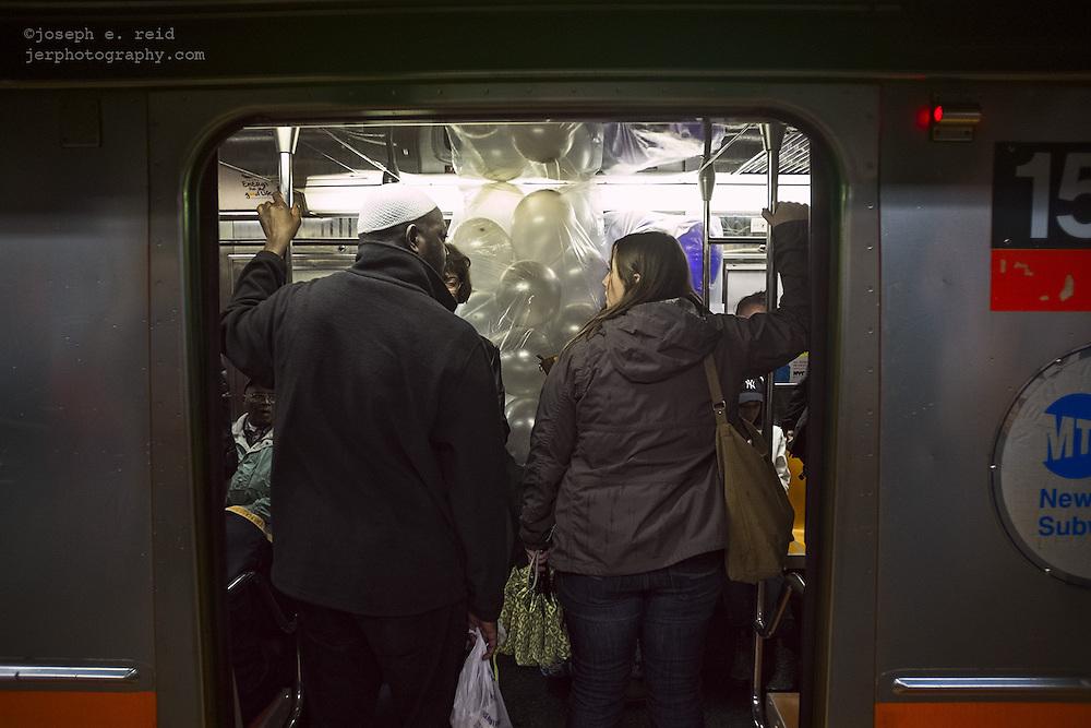 Balloons on subway car, New York, NY, US