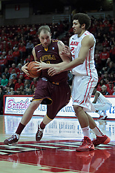 11 January 2014:  Cody Johnson picks up his dribble, looking for the hoop guarded by Reggie Lynch during an NCAA  mens basketball game between the Ramblers of Loyola University and the Illinois State Redbirds  in Redbird Arena, Normal IL.  Redbirds win 59-50