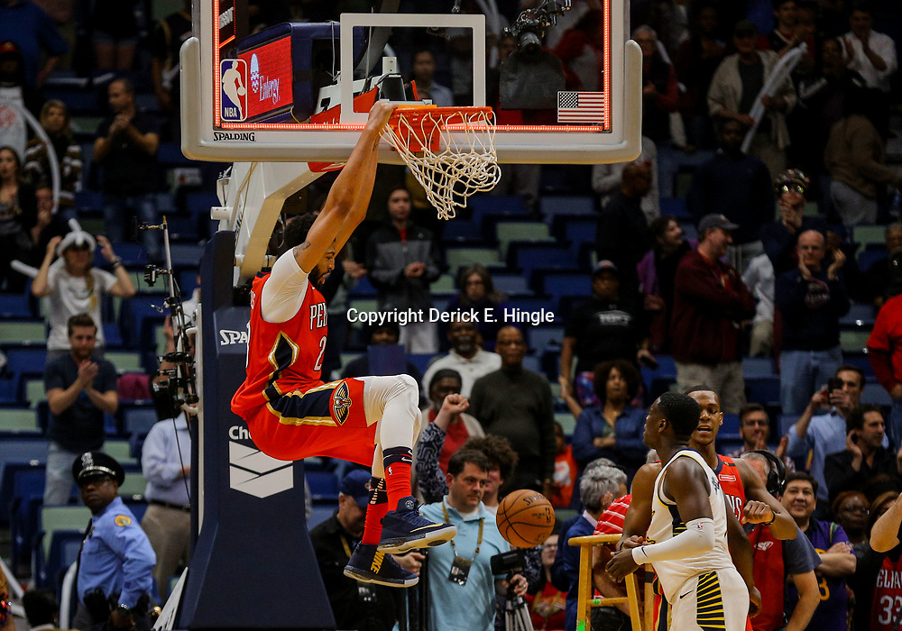 Mar 21, 2018; New Orleans, LA, USA; New Orleans Pelicans forward Anthony Davis (23) dunks on the opposite end of the court following the end of the game to celebrate a win against the New Orleans Pelicans at the Smoothie King Center. The Pelicans defeated the Pacers 96-92. Mandatory Credit: Derick E. Hingle-USA TODAY Sports
