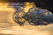 Lump of ice, backlit by the sun, floating in Kongsfjord, Spitsbergen | Isklump opplyst av solen, flytende i Kongsfjord på Svalbard