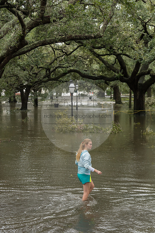 A young girl walks through flood water in White Point Garden in historic downtown after Hurricane Matthew passed through causing flooding and light damage to the area October 8, 2016 in Charleston, South Carolina. The hurricane made landfall near Charleston as a Category 2 storm but quickly diminished as it moved north.