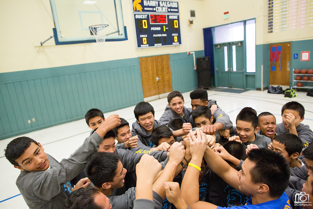 Jeremy Salgado starts a chat with the Sierramont Middle School boys basketball team during the Harry Salgado scoreboard dedication ceremony at Sierramont Middle School in San Jose, California, on January 8, 2015. (Stan Olszewski/SOSKIphoto)