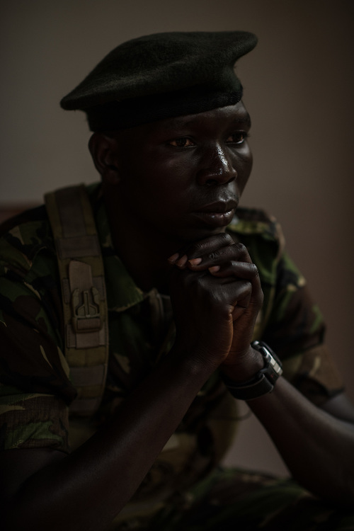 """John Agele Adriko, 33, from Aru Province, sits for a portrait at Garamba National Park on November 25, 2017. Adriko  has been a ranger for 11 years in Garamba National Park, a park embattled with numerous threats to its wildlife. <br /> <br /> """"There are some people when they see a snake they're are scared ant their reaction is to flee. There are other people who when they see a snake they are not scared and move closer to see what kind of snake it is."""""""