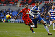Reading defender, Michael Hector gets the ball away from danger during the Sky Bet Championship match between Reading and Blackburn Rovers at the Madejski Stadium, Reading, England on 20 December 2015. Photo by Andy Walter.