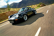 Image of a black sports car hot rod coupe in the California desert, 1974 Porsche 911 RSR Carrera Replica, American Southwest, model and property released