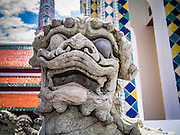 05 MAY 2013 - BANGKOK, THAILAND:   Mythical lions guards a chedi on the grounds of the Grand Palace in Bangkok. The Grand Palace is a complex of buildings at the heart of Bangkok. The palace has been the official residence of the Kings of Siam (and later Thailand) since 1782. The king, his court and his royal government were based on the grounds of the palace until 1925. The present monarch, King Bhumibol Adulyadej (Rama IX), currently resides at Chitralada Palace, but the Grand Palace is still used for official events. Several royal ceremonies and state functions are held within the walls of the palace every year. Construction of the palace began on 6 May 1782, at the order of King Buddha Yodfa Chulaloke (Rama I), the founder of the Chakri Dynasty, when he moved the capital city from Thonburi to Bangkok. Throughout successive reigns, many new buildings and structures were added, especially during the reign of King Chulalongkorn (Rama V).     PHOTO BY JACK KURTZ