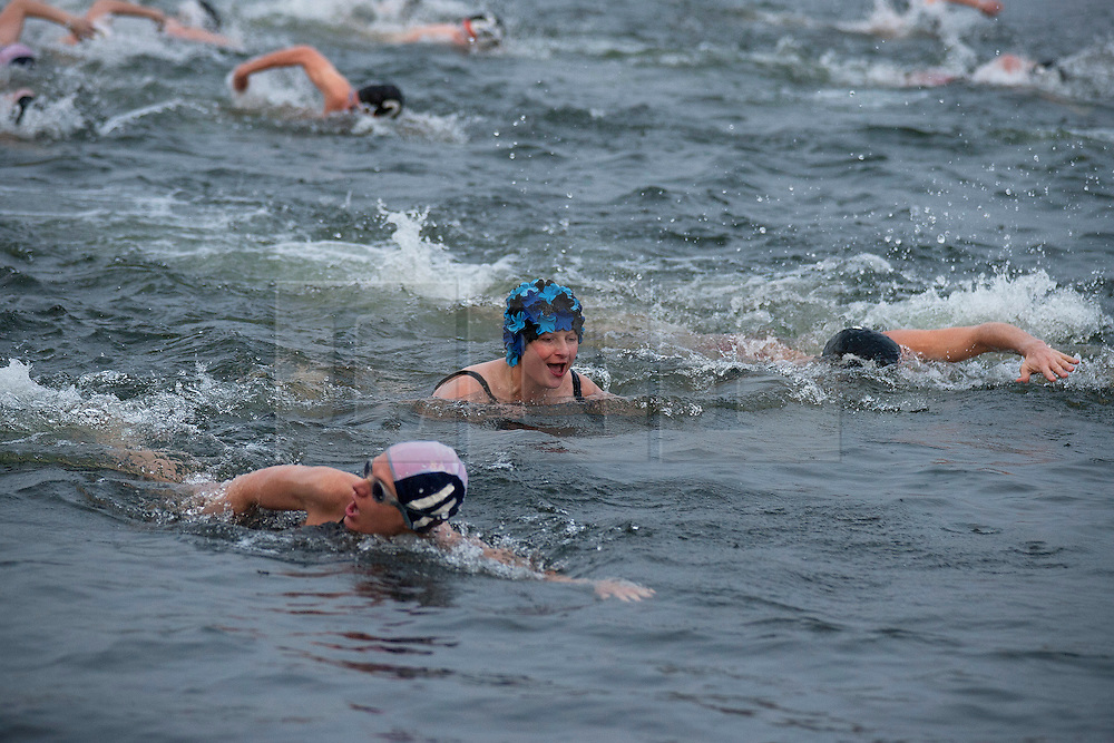 © Licensed to London News Pictures. 25/12/2011. LONDON, UK. Members of the Serpentine Swimming Club carry out their Christmas Day Swim in Hyde Park London. The race, known as the Peter Pan Cup after former patron and author JM Barrie, is a tradition dating back to 1864. Photo credit: Matt Cetti-Roberts/LNP