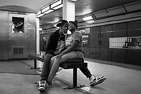 Taysia Taylor, 18, embraces her boyfriend Traevon Randell, 20, as they wait for a southbound Red Line train to take them home from the Roosevelt stop.<br />