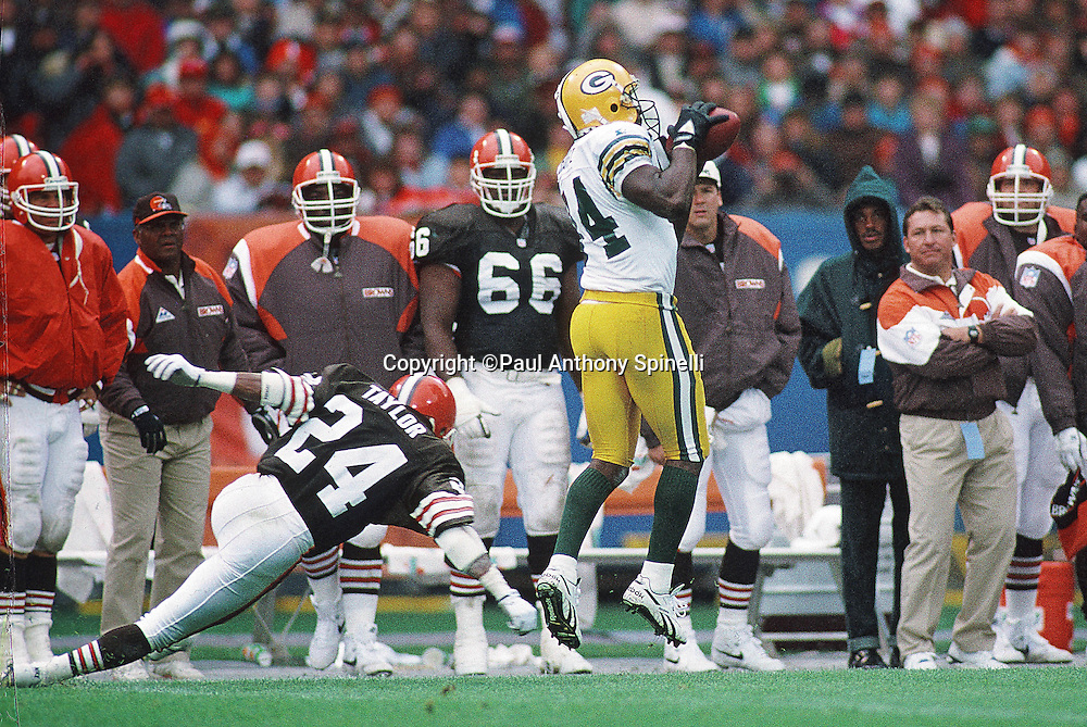 Green Bay Packers wide receiver Sterling Sharpe (84) leaps and catches a pass while covered by Cleveland Browns cornerback Terry Taylor (24) during the NFL football game against the Cleveland Browns on Oct. 18, 1992 in Cleveland. The Browns won the game 17-6. (©Paul Anthony Spinelli)