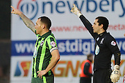 Barry Fuller (Captain) of AFC Wimbledon and James Shea (Goalkeeper) of AFC Wimbledon synchronise their orders during the Sky Bet League 2 match between Exeter City and AFC Wimbledon at St James' Park, Exeter, England on 28 December 2015. Photo by Stuart Butcher.