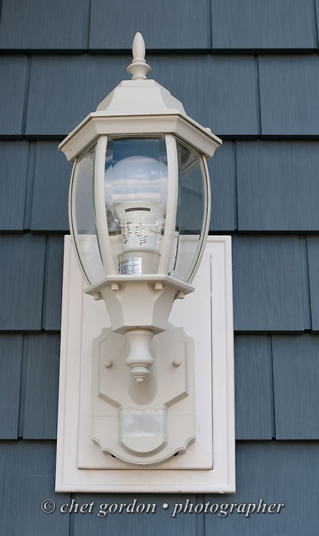 Electrical lamp mounted at the front door of Craig Furer's Cranford, NJ home on Sunday, October 23, 2016. Furer and his wife Jen hired Magnolia Home Remodeling Group to complete a full exterior makeover. The company replaced the siding with shake and clapboard, added various architectural accents, replaced the roof, modified the roofline, built a front portico and replaced two windows. Craig spent a lot of time researching this project before it began and is thrilled with the overall result.  © Chet Gordon for Angie's List