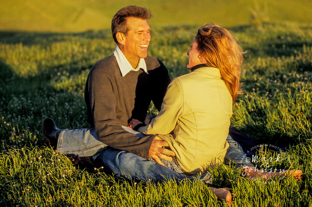 Happy couple in a grassy field