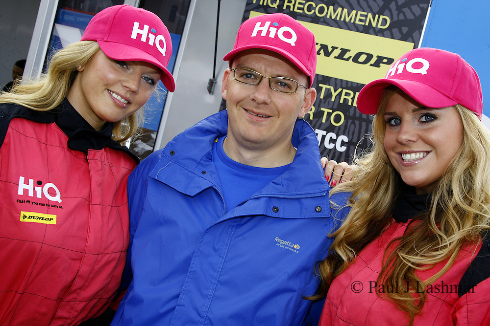 Pink Giirls with HiQ Breast Cancer support hats and a visitor to the stand