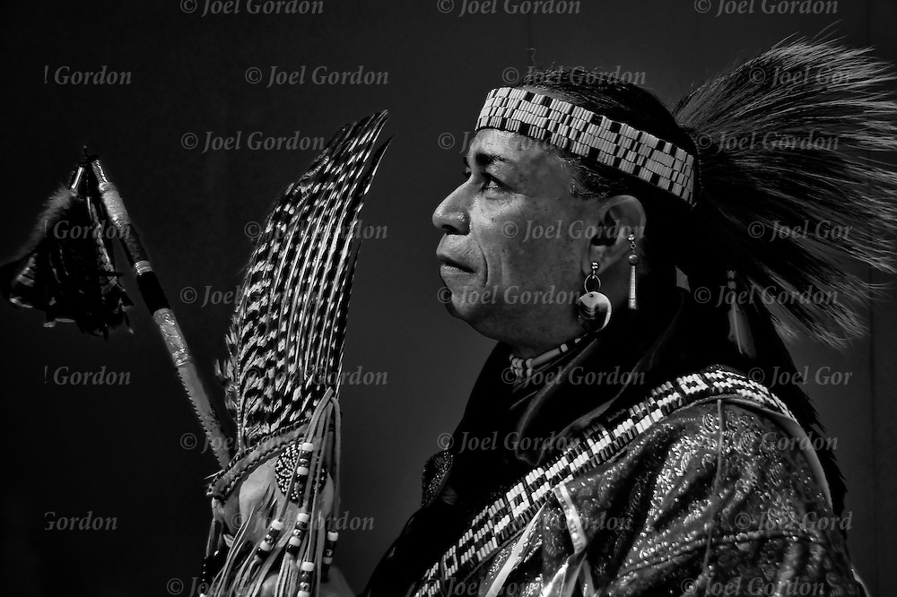 D.Salvatore Timerwolf Lamia dressing in traditional regalia, Tribal Ancestry: Shinnecock Indian Nation, Paukatuck Eastern Pequot. Inter tribal Dancing a celebration of ethnic Native American pride and heritage  at Thunderbird Pow Wow.<br /> <br /> release # 2276, # 2452