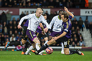Steven Naismith of Everton (left) evades the challenge from Mark Noble of West Ham United (right) during the FA Cup match at the Boleyn Ground, London<br /> Picture by David Horn/Focus Images Ltd +44 7545 970036<br /> 13/01/2015