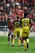 Bristol City defender Nathan Baker (6) rises highest to head the ball during the EFL Sky Bet Championship match between Bristol City and Burton Albion at Ashton Gate, Bristol, England on 13 October 2017. Photo by Richard Holmes.