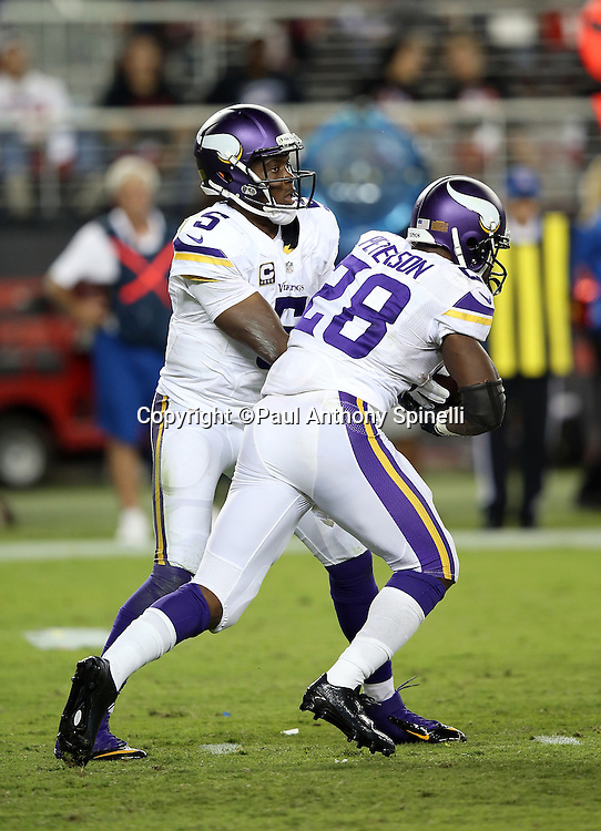 Minnesota Vikings quarterback Teddy Bridgewater (5) hands off the ball to Minnesota Vikings running back Adrian Peterson (28) during the 2015 NFL week 1 regular season football game against the San Francisco 49ers on Monday, Sept. 14, 2015 in Santa Clara, Calif. The 49ers won the game 20-3. (©Paul Anthony Spinelli)