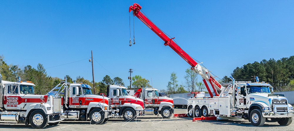 Mack Trucks are pictured at Mike Adams Towing and Air Cushion Recovery, March 22, 2016, in Macon, Georgia. Adams started his business with a 1993 with a 1989 Mack Super-Liner. Today, he owns 27 towing and recovery trucks, nearly a third of which are Macks. His newest acquisition, far right, is a 2016 Mack Granite with a 50-ton Century rotator. (Photo by Carmen K. Sisson/Cloudybright)