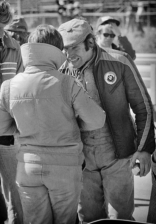 Italian Formula One driver Vittorio Brambilla, offers advice to fellow Italian Formula One driver Lella Lombardi, here in 1975, at the United States Grand Prix, driving for the Frank Williams team. Brambilla was coming off a surprise victory at the Austrian Grand Prix earlier that season, and took Lombardi under his wing. <br />