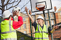 Manual workers playing basketball