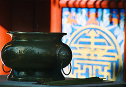 "China, Wutai Shan, 2007. A bronze incense burner in the morning light at one of Wutai's many Buddhist temples. ""Five-Terrace Mountain,"" as it is known, is one of China's four major monastic communities.."