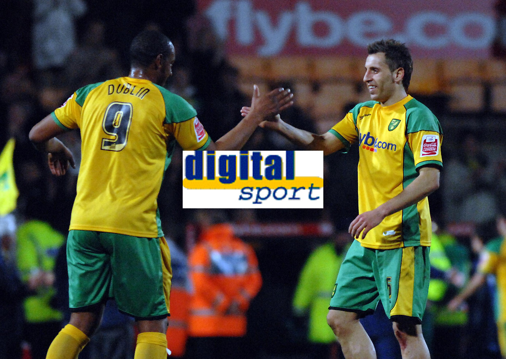 Photo: Ashley Pickering.<br /> Norwich City v Birmingham City. Coca Cola Championship. 13/03/2007.<br /> Norwich goal scorer Darren Huckerby (R) is congratulated by Dion Dublin at the end of the game
