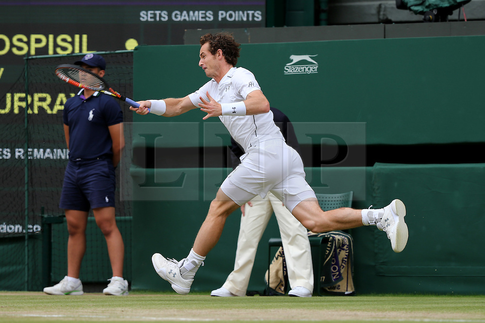 © London News Pictures. Andrew Murray (GB) beats Vasek Pospisil (CAN) in centre court at the Wimbledon Tennis Championships today 08.07.2015. Photo credit: LNP
