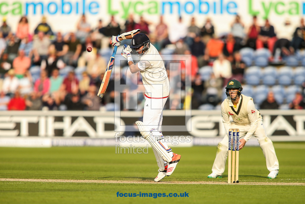 Stuart Broad of England (left) plays a rising delivery during the Investec Ashes Series Test Match at Sophia Gardens, Cardiff<br /> Picture by Andy Kearns/Focus Images Ltd 0781 864 4264<br /> 08/07/2015