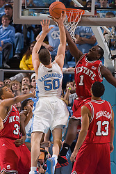12 January 2008: North Carolina Wolfpack forward JJ Hickson (1) guards Tar Heels forward Tyler Hansbrough (50) during a 62-93 loss to the North Carolina Tar Heels at the Dean Smith Center in Chapel Hill, NC.