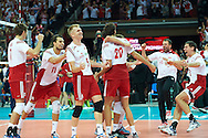 Poland's (L-R) Karol Klos and Fabian Drzyzga and Pawel Zagumny and Mateusz Mika and Michal Kubiak celebrate winning the point and match and gold medal while volleyball final match between Brazil and Poland during the 2014 FIVB Volleyball World Championships at Spodek Hall in Katowice on September 21, 2014.<br /> <br /> Poland, Katowice, September 21, 2014<br /> <br /> For editorial use only. Any commercial or promotional use requires permission.<br /> <br /> Mandatory credit:<br /> Photo by © Adam Nurkiewicz / Mediasport