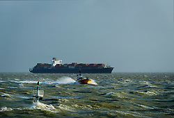 February 14, 2016 - ''Container ship sailing on the Westerschelde river, towards open sea, after visiting Antwerp harbour. The pilot has been collected from the ship by the pilots boat' (Credit Image: © Cultura via ZUMA Press)