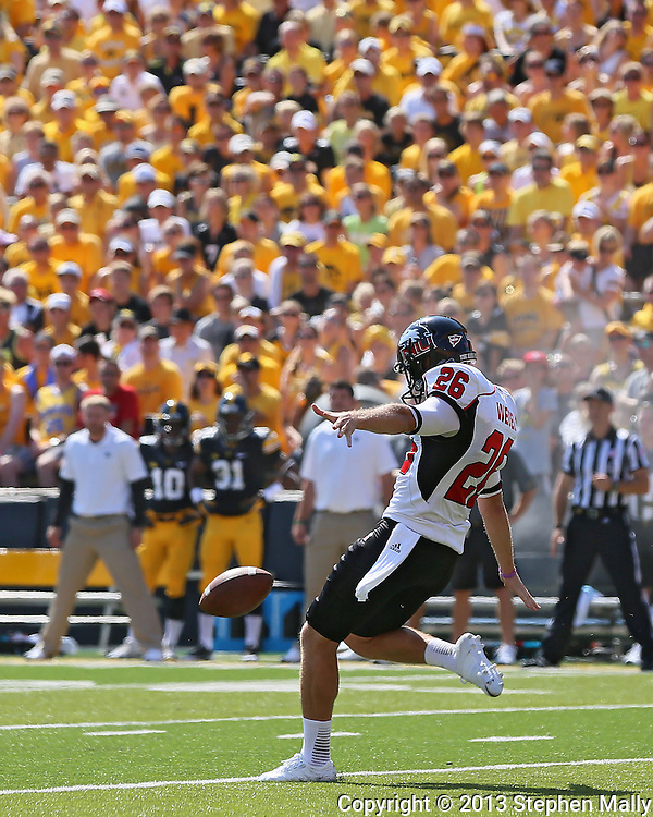 August 31 2013: Northern Illinois Huskies punter Tyler Wedel (26) punts the ball away during the first quarter of the NCAA football game between the Northern Illinois Huskies and the Iowa Hawkeyes at Kinnick Stadium in Iowa City, Iowa on August 31, 2013. Northern Illinois defeated Iowa 30-27.