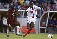 Fotball<br /> Frankrike 2004/05<br /> Metz v Lyon<br /> 21. august 2004<br /> Foto: Digitalsport<br /> NORWAY ONLY<br />  ERIC ABIDAL (LYON) / HERVE TUM (METZ)