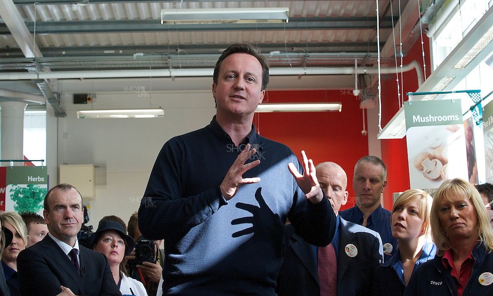 Britain's opposition Conservative Party leader, David Cameron speaks to Tesco staff at a Tesco supermarket on May 2, 2010 in Holywell, Flintshire, North Wales.