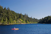 Kayakers on Carter Lake; Oregon Dunes National Recreation Area, Oregon coast.