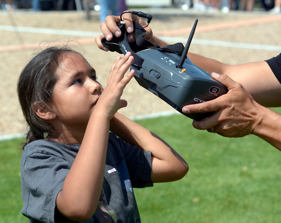 gbs062517h/ASEC - Harold Rogers, 8, left, puts on video goggles with help from Shaun Taylor with Southwest Pod Racing, sets up Harold Rogers, 8, to fly a drone during the Drone Discovery Day at the Anderson Abruzzo Albuquerque International Balloon Museum on Sunday, June 25, 2017. (Greg Sorber/Albuquerque Journal)