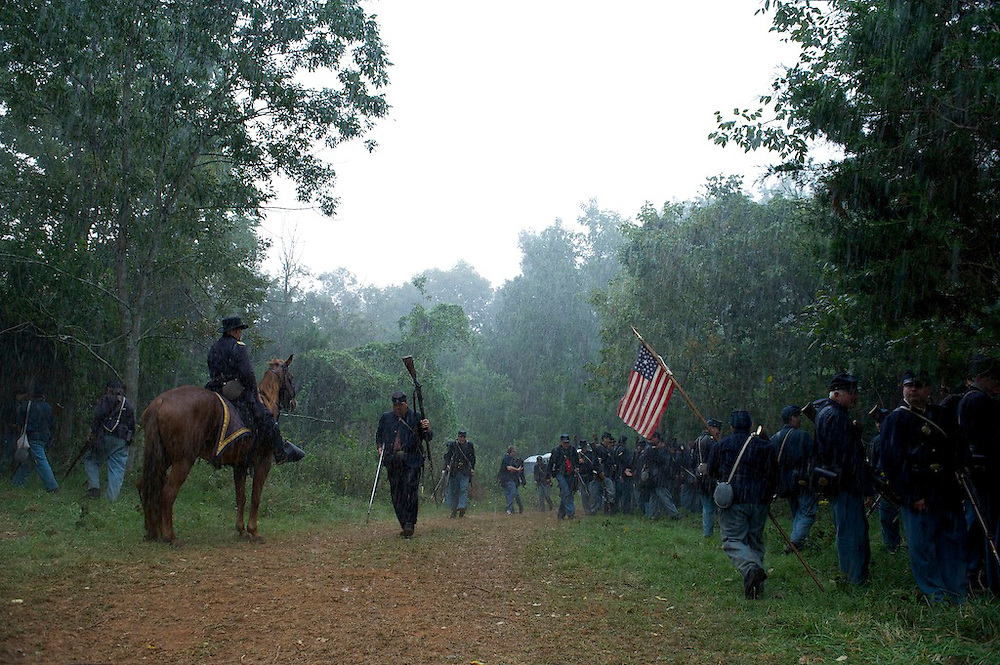 Union forces make their way to shelter when a downpour interrupts the 150th Antietam Civil War Reenactment in Boonsboro, MD on September 8, 2012.