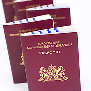 Nederland Nieuw-Lekkerland 19-07-2009 20090719 Foto: David Rozing ..Nederlandse paspoorten, op de kaft de tekst Europese unie koninkrijk der Nederland paspoort Holland, Dutch passports , permit, permits, pass, identity documents, document. The Netherlands, dutch, Pays Bas, Europe,  Foto: David Rozing