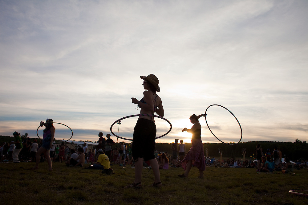 Festival attendees play with hula-hoops to the music at The Nateva Music and Camping Festival in Oxford, Maine over the 4th of July Weekend 2010.