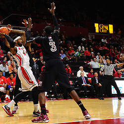 J.J. Moore #44 of the Rutgers Scarlet Knights looks for an outlet against the Temple Owls press during the second half of Rutgers men's basketball vs Temple Owls in American Athletic Conference play on Jan. 1, 2014 at Rutgers Louis Brown Athletic Center in Piscataway, New Jersey.