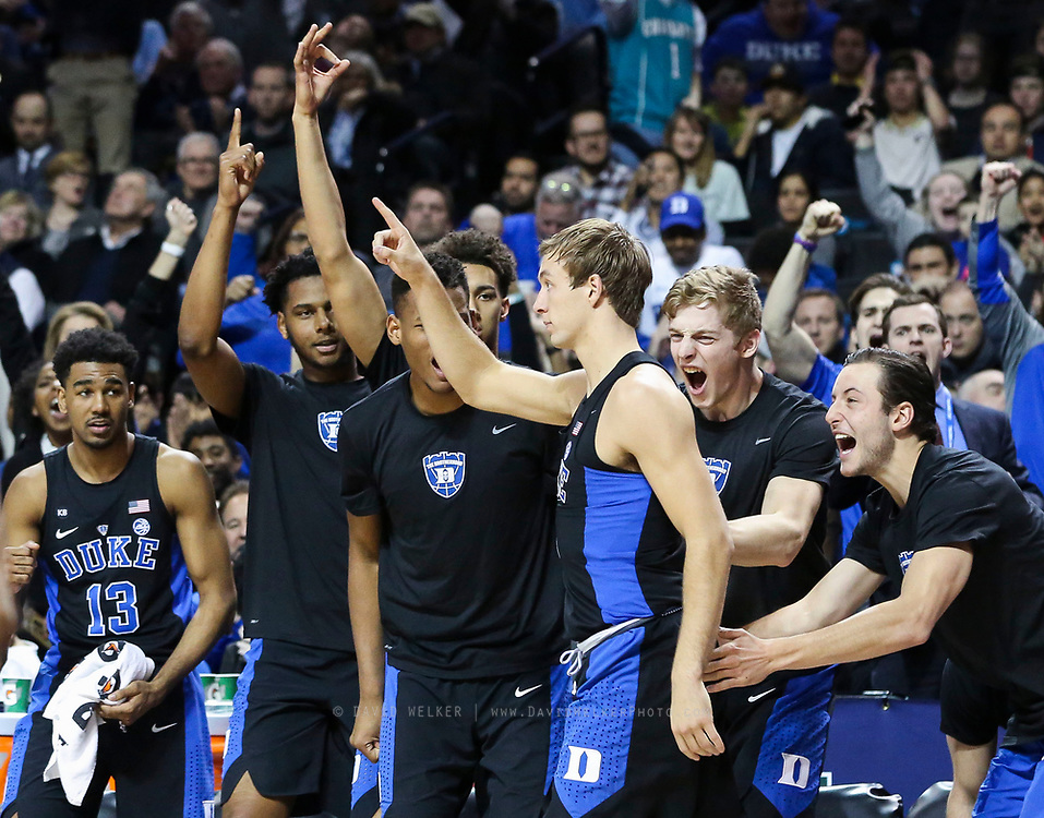 The Duke bench reacts after Duke guard Luke Kennard (5) made a three during the semifinals of the 2017 New York Life ACC Tournament at the Barclays Center in Brooklyn, N.Y., Friday, March 10, 2017. (Photo by David Welker, theACC.com)