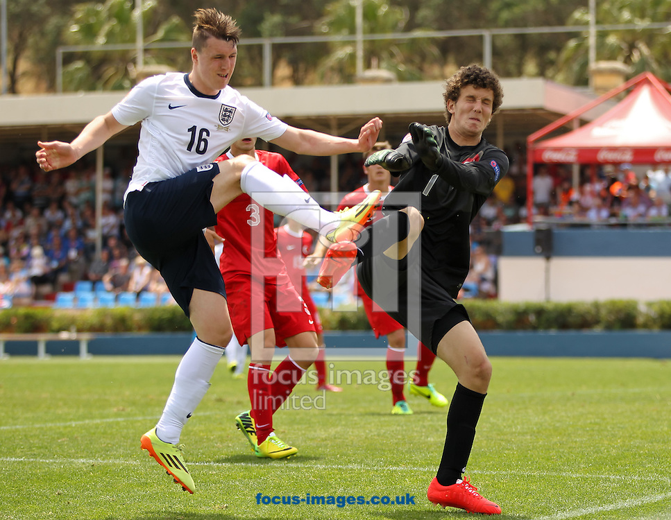 Callum Cooke (left) of England collides with Tarik &Ccedil;etin (right) of Turkey during the 2014 UEFA European Under-17 match at Gozo Stadium, Xewkija<br /> Picture by Tom Smith/Focus Images Ltd 07545141164<br /> 12/05/2014
