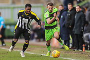 Forest Green Rovers Christian Doidge(9) takes on Notts County Mitch Rose(26) during the EFL Sky Bet League 2 match between Forest Green Rovers and Notts County at the New Lawn, Forest Green, United Kingdom on 9 February 2019.