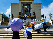 22 OCTOBER 2017 - BANGKOK, THAILAND: People pray at the statue of Rama I, the founder of the Chakri Dynasty, south of Pak Khlong Talat, the flower market, in Bangkok. There is a replica crematorium to honor Bhumibol Adulyadej, the Late King of Thailand, near the statue and the street in front of the market features elaborate floral displays in the late king's honor. The King died in October 2016 and will be cremated on 26 October 2017.     PHOTO BY JACK KURTZ