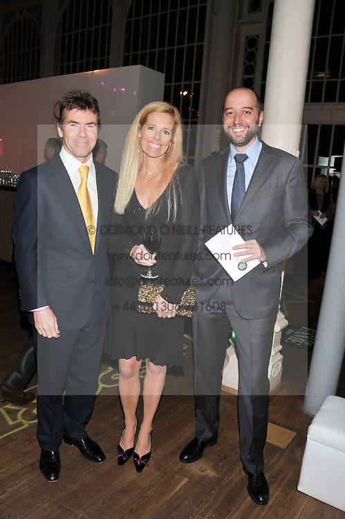 Left to right, PAUL & VICTORIA STEWART and GERARD LOPEZ the Chairman of the Lotus Formula One team at the Motor Sport magazine's 2013 Hall of Fame awards at The Royal Opera House, London on 25th February 2013.
