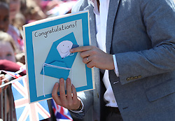 The Duke of Sussex is given a congratulations card by local schoolchildren as he arrives for a visit to the Barton Neighbourhood Centre in Oxford.